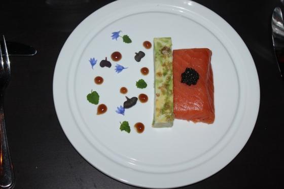 smoked salmon, avocado terrine, with edible flowers and maple bourbon